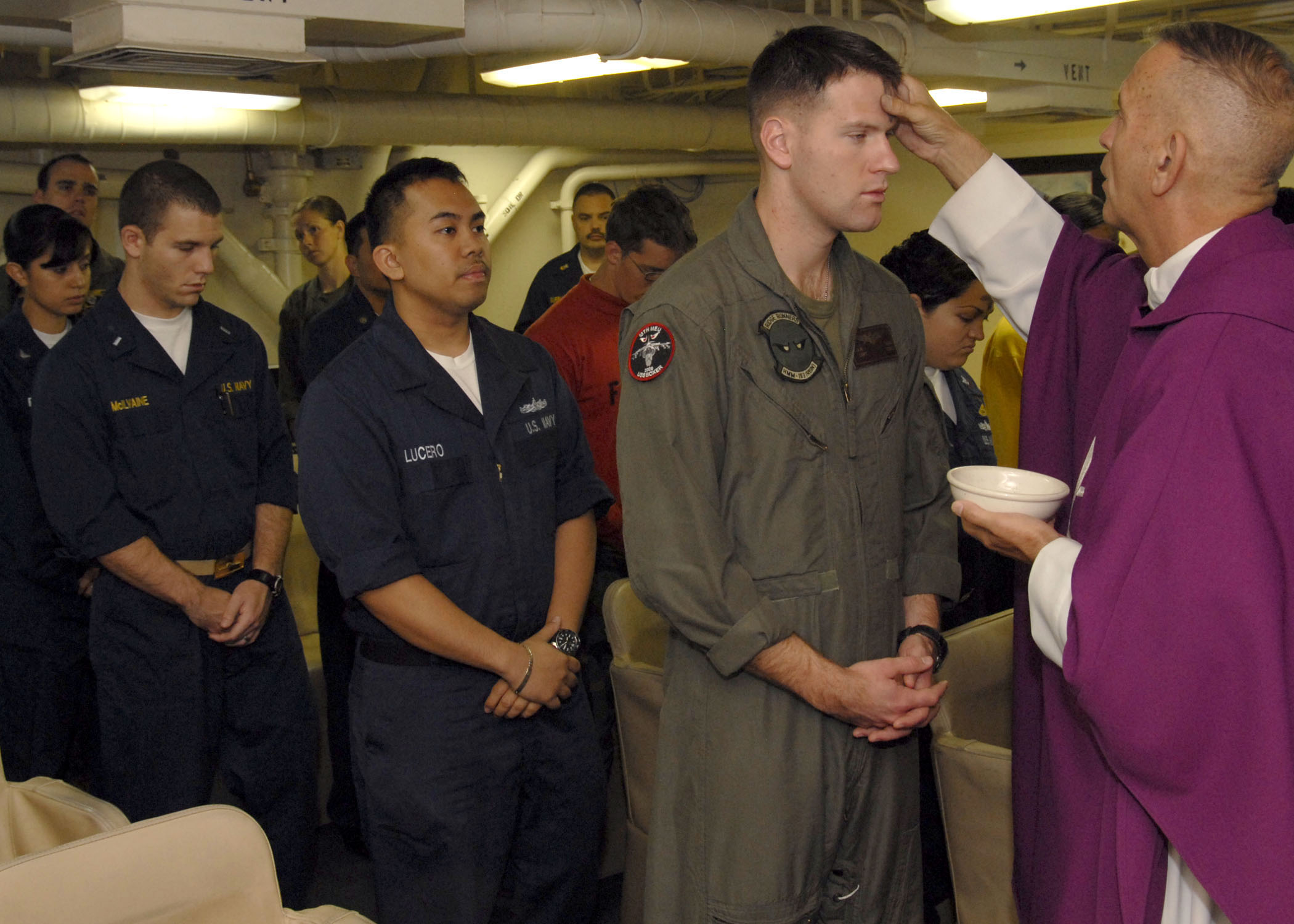 file sailors and marines prepare to receive ashes during