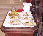 Credence Table with Cruets, Hosts, and Sacred Vessels 001.jpg